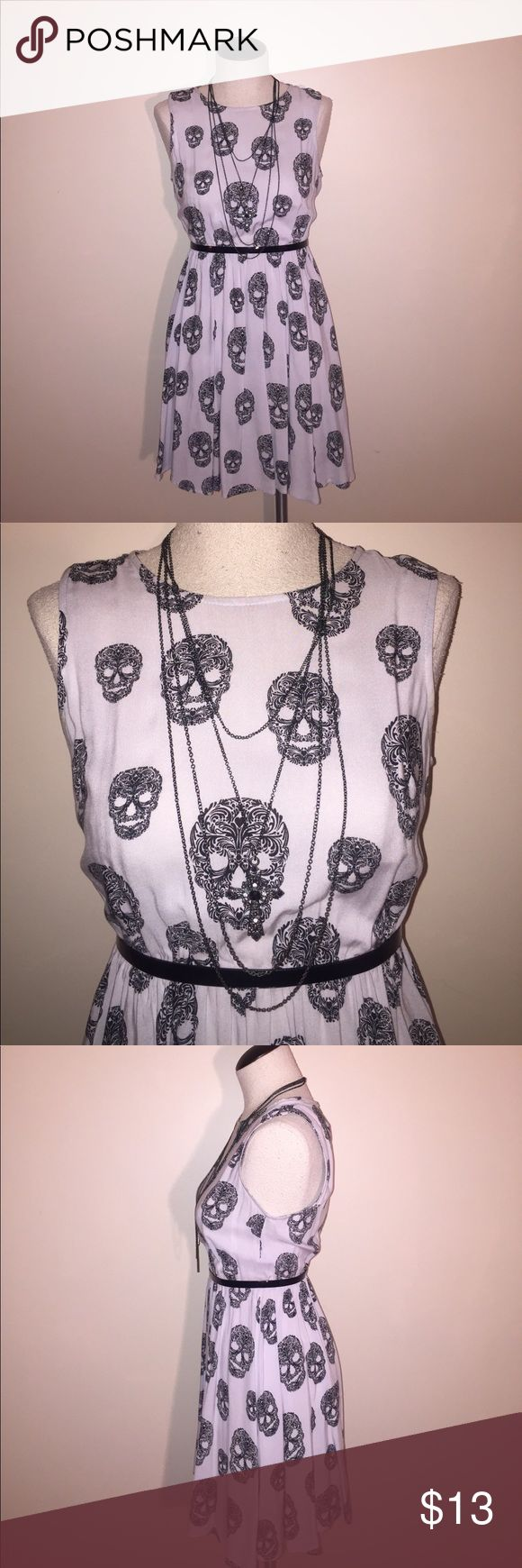 H&M Black and Gray Sugar Skull Dress Size 4 Light weight and comfy this dress can be worn all year round super versatile by itself in the summer or with tights and a cardigan in the fall! H&M only worn a few times excellent condition size 4! (Belt and necklace not included) H&M Dresses Mini