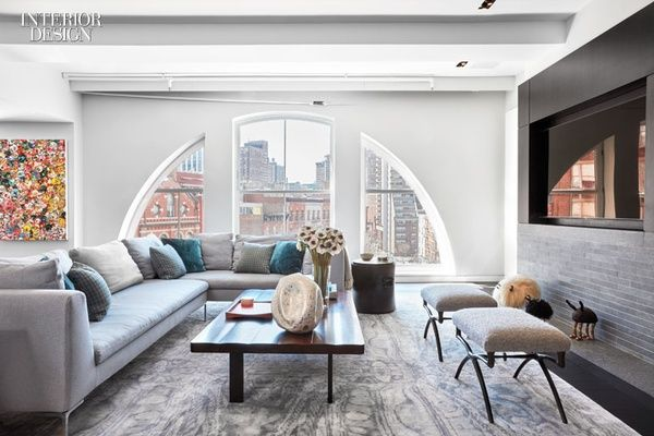 An Antonio Citterio sofa faces a Tyler Hays table in the den. Photography by Garrett Rowland. TriBeCa Renovation by Damon Liss and Wunderground Makes Room for Play
