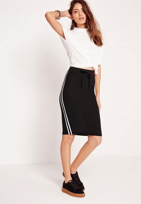 Add a punch of athleisure to your new season look in this pencil skirt. Featuring an always classic black hue, pencil style and a white side stripe, you'll look effortlessly casual whilst keeping your style game strong. Style with trainers,...