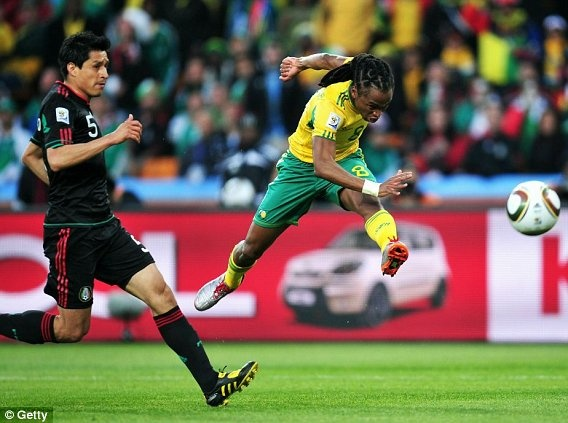 Siphiwe Tshabalala of South Africa scores the first goal during the 2010 FIFA World Cup South Africa Group A match between South Africa and Mexico at Soccer City Stadium on June 11, 2010 in Johannesburg, South Africa.