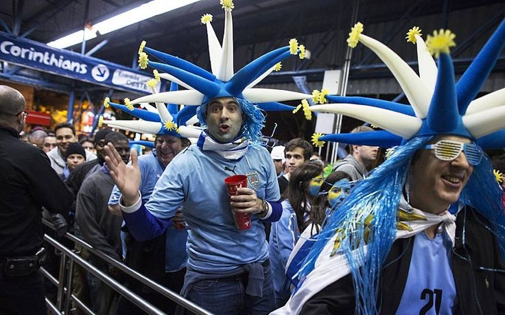 Jubilant fans of the Uruguay football team leave Arena de Sao Paulo stadium after Uruguay's 2-1 victory over England in Sao Paulo, Brazil