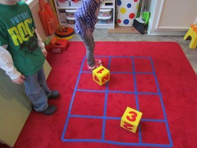 """Maths Games - using whole bodies in the maths process helps us to reinforce basic maths skills as well. Throw the large die to dictate how many steps, hops, or squares to go. Create games indoors & outdoors that invite mathematical thinking & large motor movement ("""",)"""