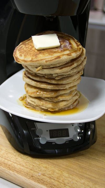 Recipe with video instructions: The bottom of your coffee maker can do more than just keep your coffee hot — it can make pancakes! Ingredients: 1 1/2 cups all-purpose flour, 3 1/2 teaspoons baking powder, 1/2 teaspoon salt, 1 tablespoon sugar, 1 teaspoon cinnamon, 1 1/4 cups whole milk, 1 egg, 3 tablespoons melted butter, 1/2 cup maple syrup