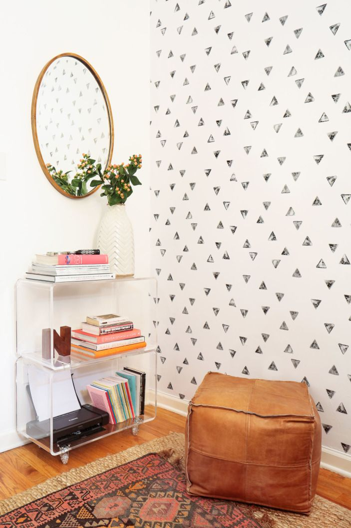 """Chasing Paper provided some beautiful <a href=""""http://www.chasingpaper.com/products/stamped-triangle target=""""_blank"""">Stamped Triangle wallpaper</a> for the feature wall. The pattern almost looks like it was hand-applied!"""