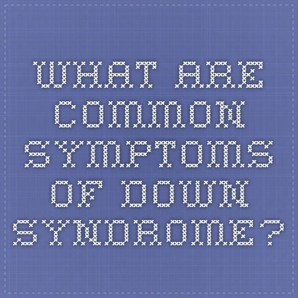 What are common symptoms of Down syndrome?