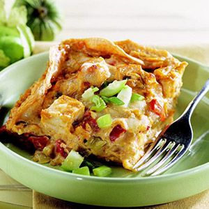Texas-Style Chicken Casserole....chicken stacked with chili peppers, tortillas,sour cream sauce & cheese...YUMM!!!!