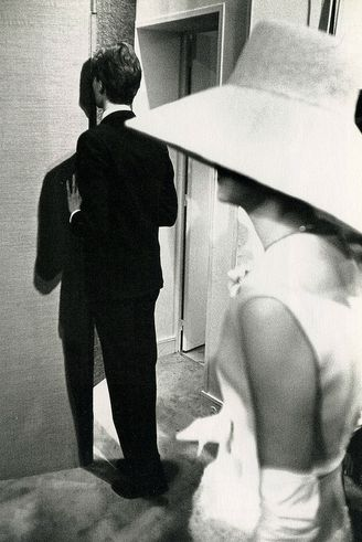 YSL sneaking a peek at the presentation of his Spring/Summer 1962 collection.