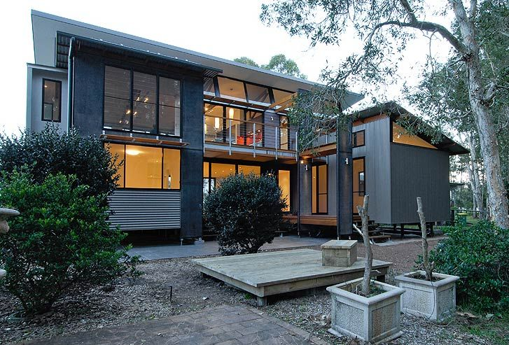 This family holiday home at Port Stephens, New South Wales uses LYSAGHT CUSTOM ORB® roofing and wall cladding made from COLORBOND® steel in ...