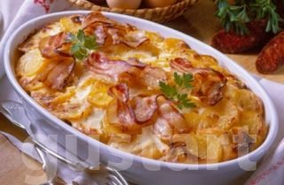 Potato layered with sausage and bioled eggs, topped with sour cream  http://hungary-special.com/gastronomy.html https://www.facebook.com/HungarySpecial?ref=hl