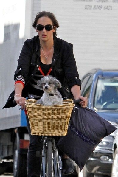 Miranda Hart seen riding her bike with her dog in the basket in West London.