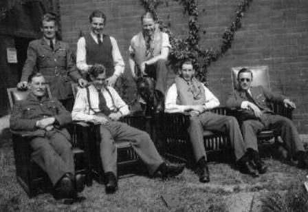 """Pilots of A Flight rest at RAF Hornchurch as No 54 Squadron RAF went into action during the evacuation from Dunkirk in 1940. When acting F/L Alan C """"Al"""" Deere (standing, first left) was forced down on a beach at De Panne on 28 May, the 22-year-old New Zealander was stopped and rasped at by an army major while joining a queue of soldiers on the mole, """"For all the good you chaps seem to be doing, you might as well stay on the ground""""."""