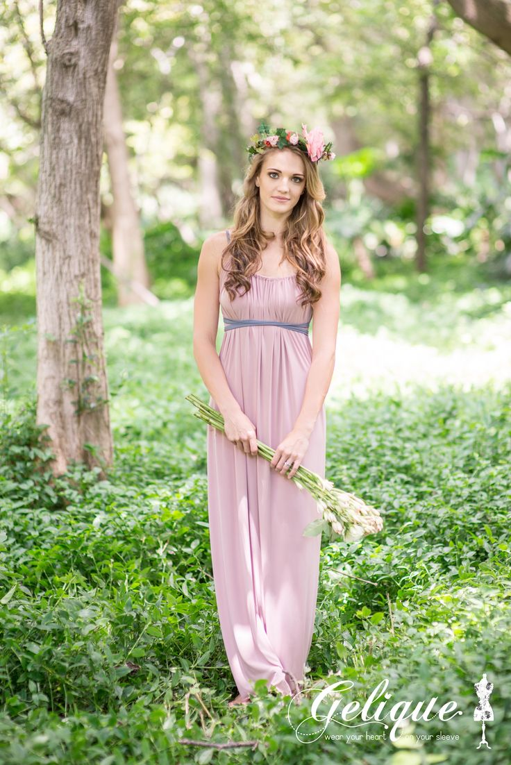 Mila Gelique bridesmaids dress. Soft pink dress. Empire style convertible bridesmaids dress. The Mila design can be worn in a variety of different styles. Available in a variety of sizes and colours from Brides of Somerset. Long, knee-length or short available. Knee length bridesmaids dress.