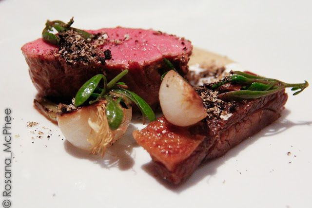 Roasted loin of lamb, crisp belly, goat's curd,  Onion ash and purslane - Amazing, in my opinion the best dish of them all! Very juicy, perfectly pink and tenderloin (perhaps sous vide?) lots of flavours and textures in this dish. The onion ash added a bitter and smoky flavour to the plate. by Chef Adam Simmonds