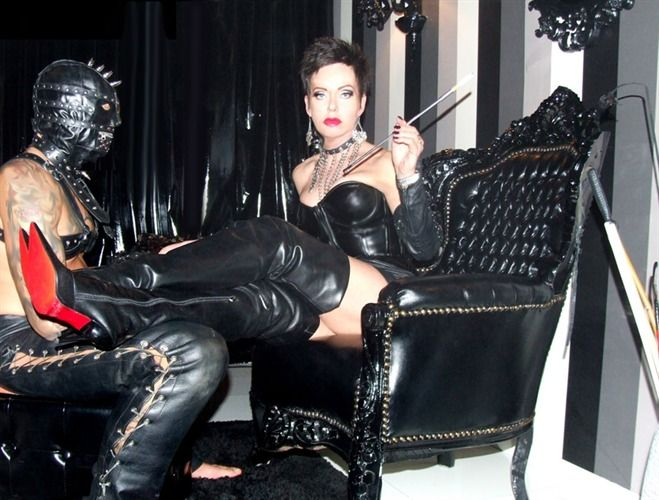 Mature dominatrix in leather smoking opinion