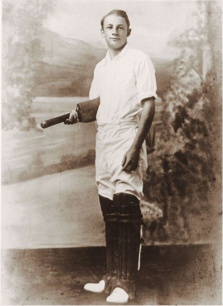 Bradman with his first bat, pictured in 1926 after making a district record 300 runs. Courtesy Bradman Museum Trust Collection Bowral.
