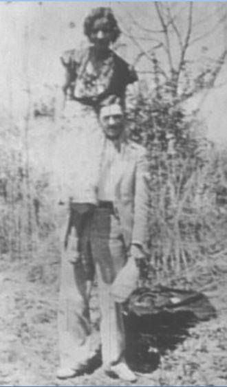 Bonnie was often carried by Clyde. This is the last photo taken of them alive.
