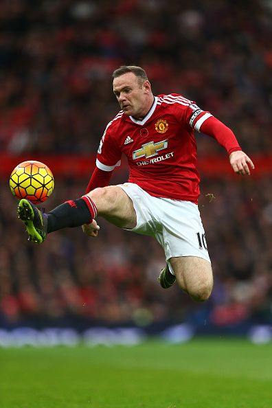 Wayne Rooney of Manchester United controls the ball during the Barclays Premier League match between Manchester United and West Bromwich Albion at...