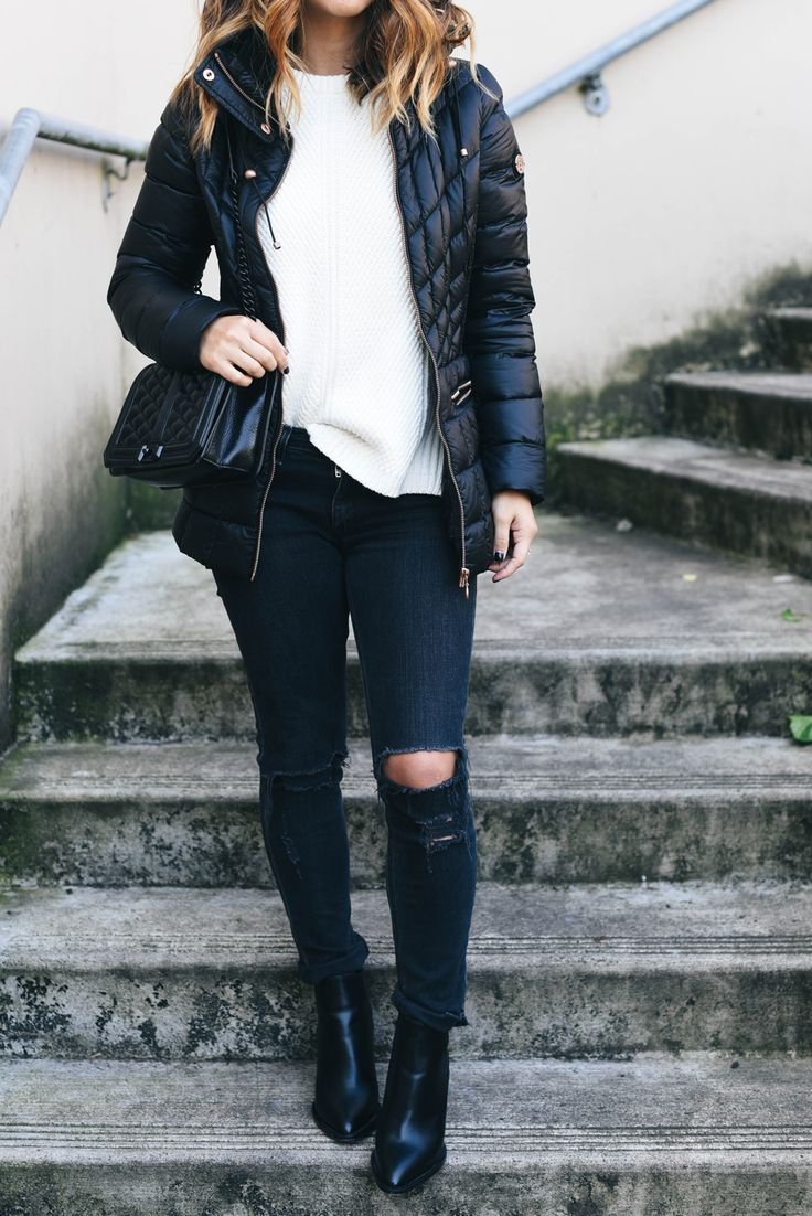 Puffy jacket styling with white sweater and black booties