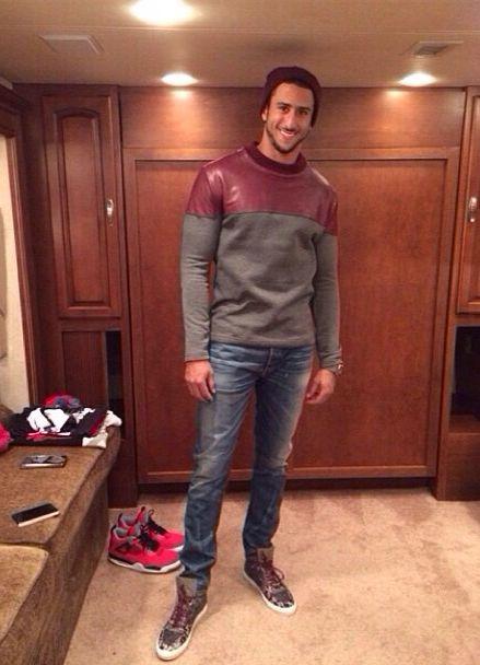 Colin Kaepernick love that  sweater! Very stylish man.