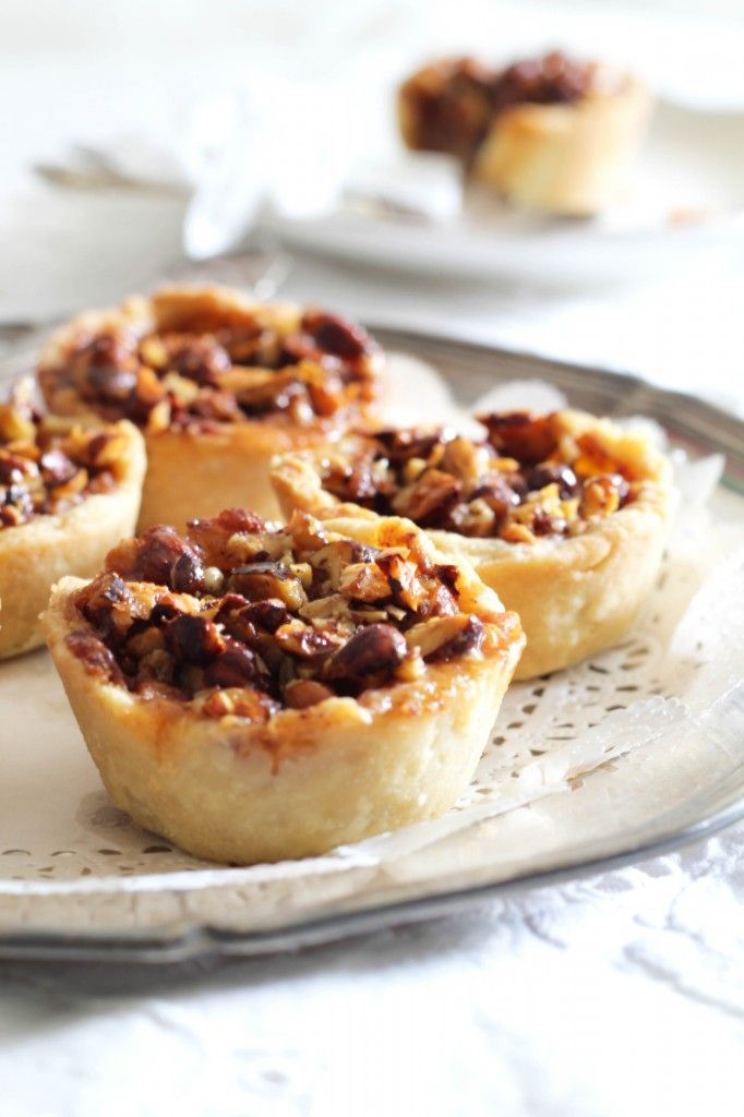 small apple pies with caramel and nuts