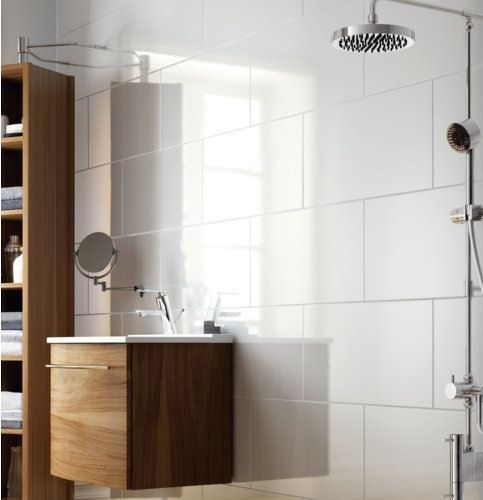 Large White Bathroom Tiles With Wood.