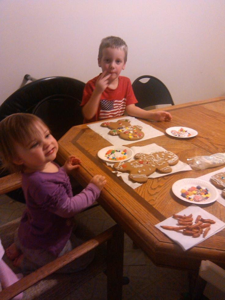 Emma & Evan decorating gingerbread men - December 2012