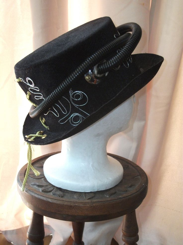 Steampunk coachman's hat with tubes and wire.