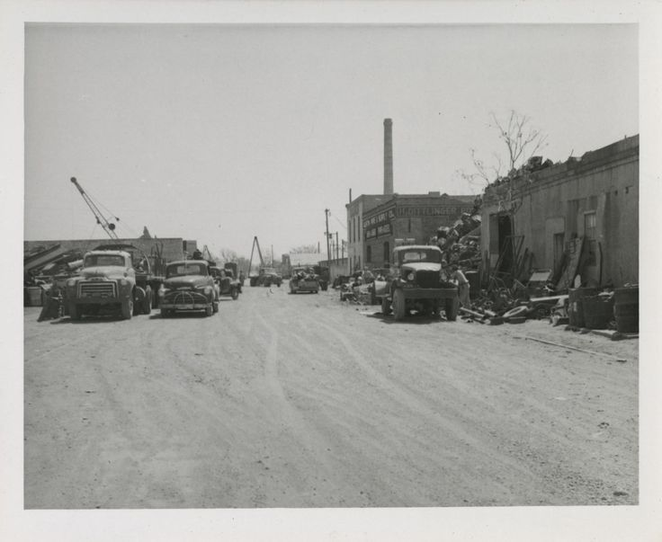 1959 Photograph of the 800 blocks of E. 4th Street looking east. Austin Pipe & Supply Co. is on the south side of the street.