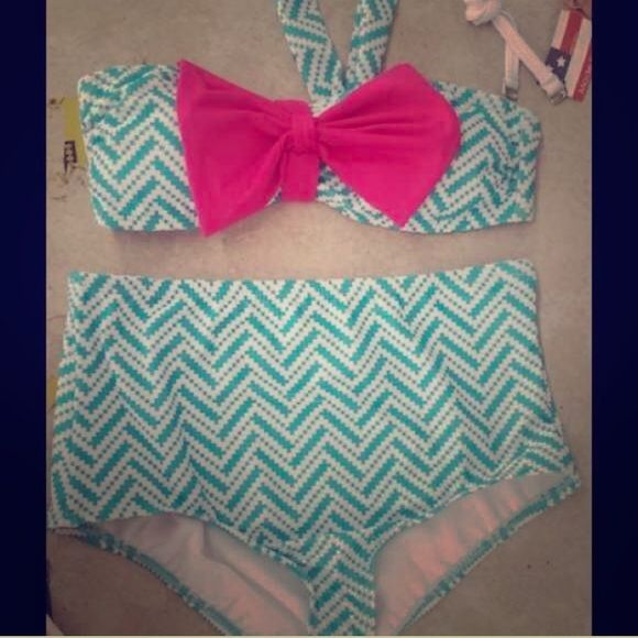 High Waisted Bikini This adorable chevron high waisted bikini would be perfect for the up coming summer! I've only worn it about 3 times. It's a little too big for me in the chest area. Make an offer if you're interested! Swim Bikinis