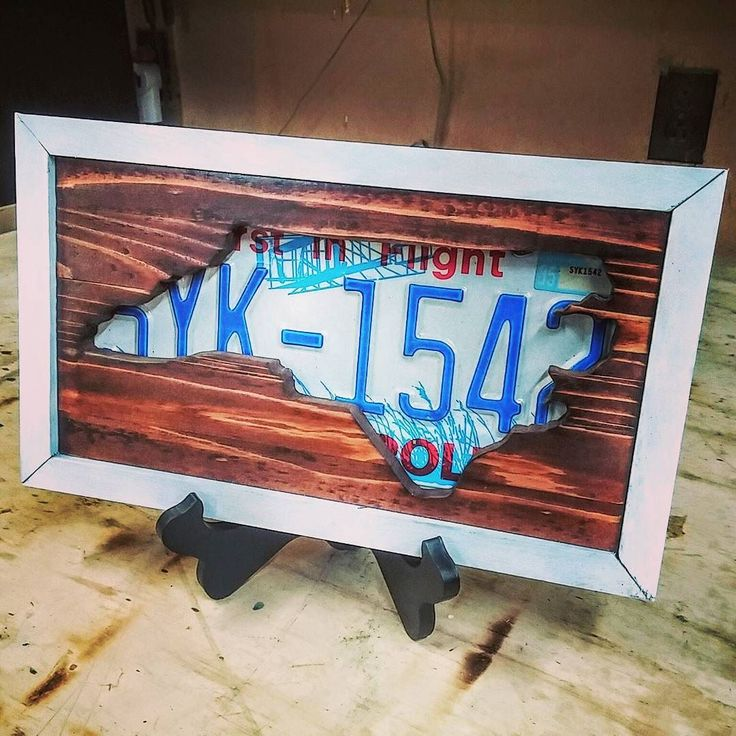 Some scrap wood and an old licence plate makes a nice piece of art.  #scrollsaw #northcarolina #licenseplate #woodart #handmade