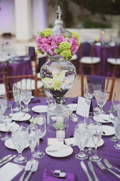 Formal Outdoor Table.  Stunning use of a terrarium with a floral topper.