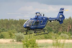A Blue Eurocopter EC135 in flight.