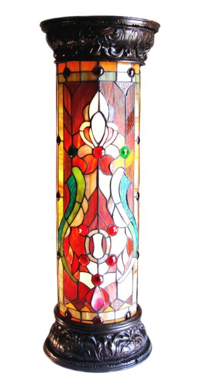 Handcrafted using the same techniques developed by Louis Comfort Tiffany in the early 1900s, this beautiful Tiffany-style table lamp contains hand-cut pieces of stained glass, each wrapped in fine cop