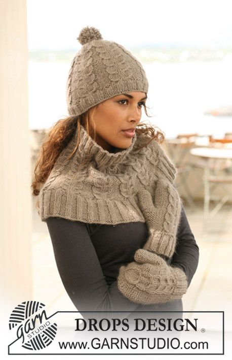 """Set comprises: Knitted DROPS hat, neck warmer and mittens with cables in """"Merino Extra Fine"""" and """"Kid-Silk""""."""