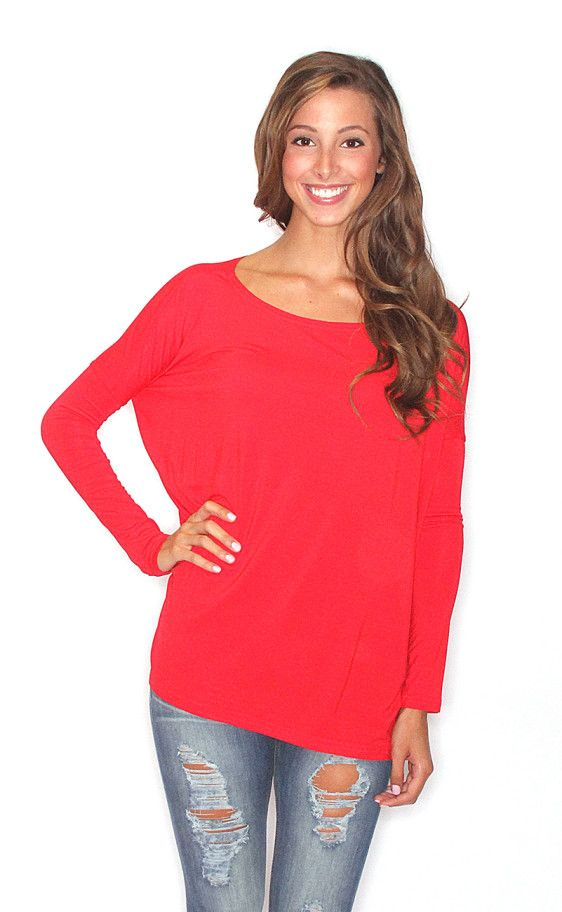 The Lulus Melana Red Long Sleeve Top is just what you need to step up your weekday style game! Sleek woven fabric forms this classic blouse with a collarless V-neck, lightly pleated shoulders, and long sleeves with notched, double cuffs for a trendy touch that won't go unnoticed!