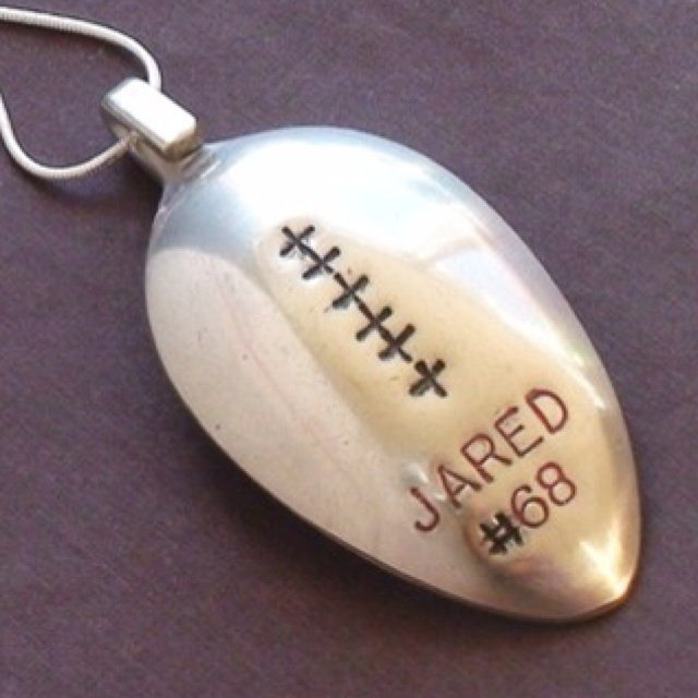Football pendant from a spoon.