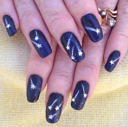17 Stunning Star Nail Designs for Fashionistas: #16. Shooting Star Nail Design