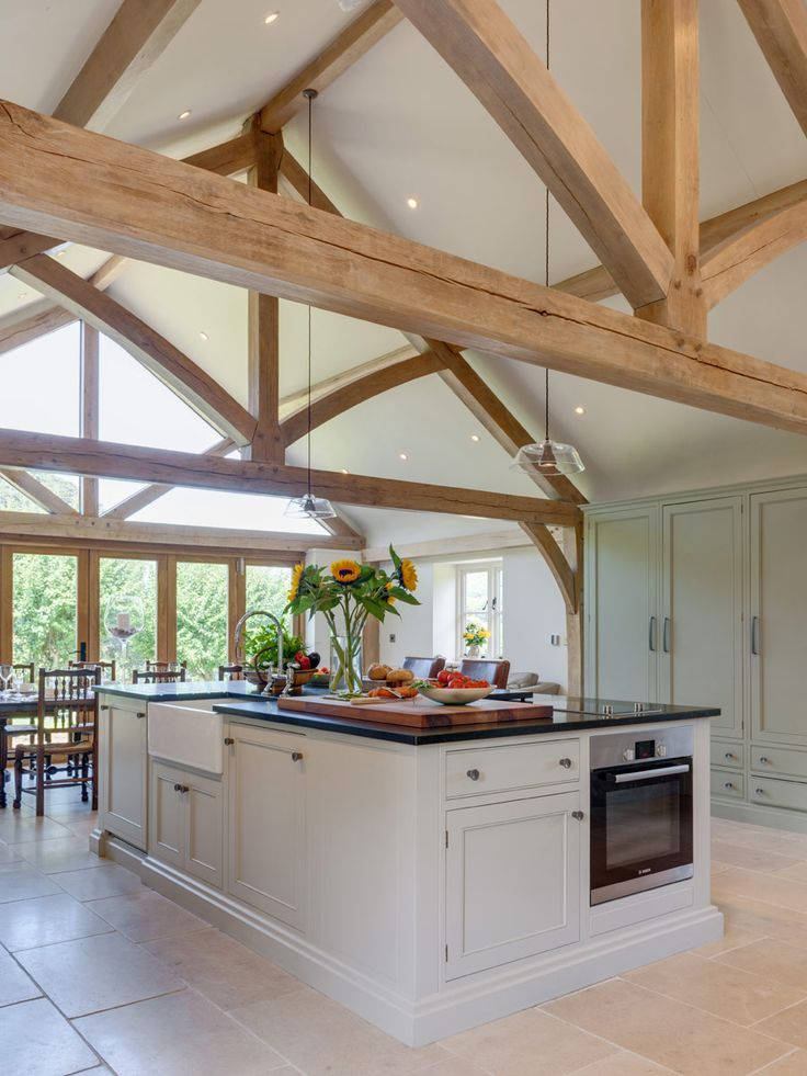 Beautiful oak frame kitchen extension from Welsh Oak Frame. The floor-to-ceiling glass accentuates the dramatic look of this vaulted ceiling and allows lots of natural light into the room.  #glazing #oakframe #kitchenextension #vaultedceiling