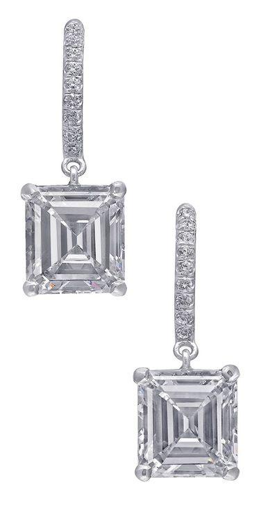 Diamond drop earrings, 2.05 carat Emerald-cut G/H color diamond, VS1 clarity, 2.02 carat Emerald-cut G/H color diamond, VS1 clarity, .19 carat Round-cut diamond. Set in platinum. Via 1stdibs.