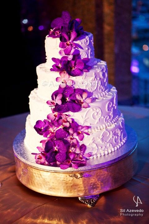 "Purple Orchid Scrolled Wedding Cake - All buttercream, iced and piping. The flowers are fresh orchids. This photo is from the wedding photographer, not me. 6""/9""/12""/15"" rounds."