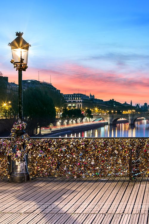 Ponts des Arts, Paris. In recent years, many tourist couples have taken to attaching padlocks (love locks) with their first names written or engraved on them to the railing or the grate on the side of the bridge, then throwing the key into the Seine river below, as a romantic gesture.
