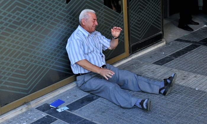 Australian heads to Greece to help pensioner pictured crying outside bank: An Australian touched by an image of a pensioner sobbing outside a Greek bank after being unable to withdraw money discovered he was a family friend. Giorgos Chatzifotiadis weeps outside a national bank branch in Thessaloniki on 3 July.