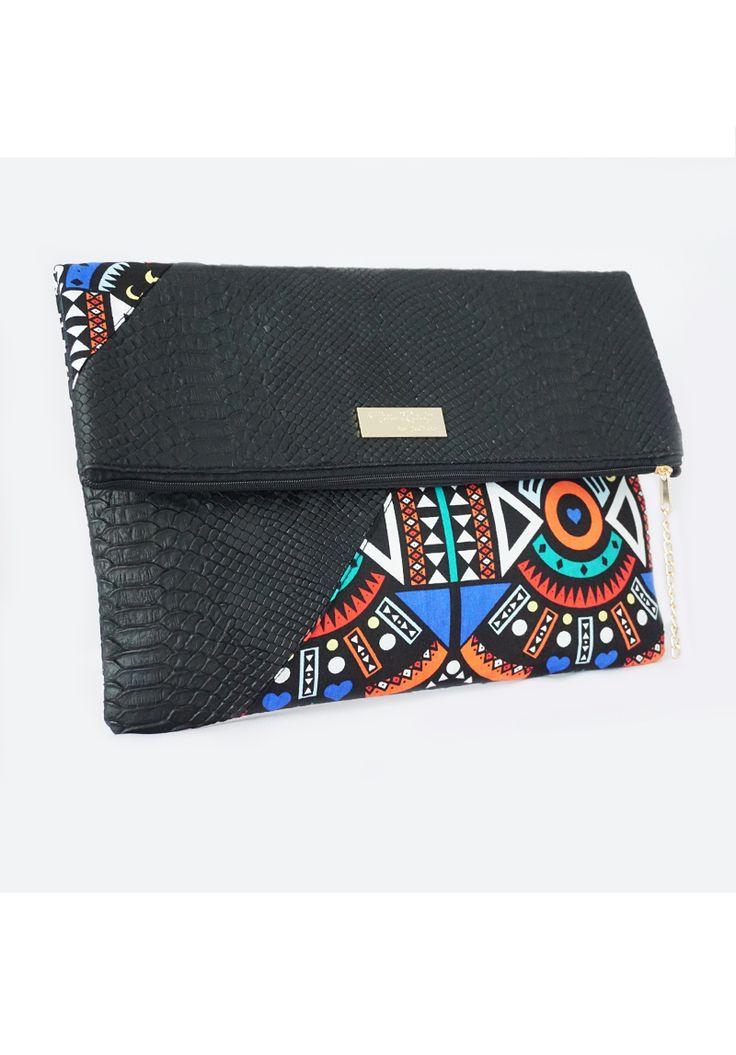 Pochette similicuir et touche de wax par Mad-Lady pour Afrikrea. https://www.afrikrea.com/article/noname-laser-pochettes-noir-tissu-similicuir/XN5IYWB?utm_content=buffer8505d&utm_medium=social&utm_source=pinterest.com&utm_campaign=buffer