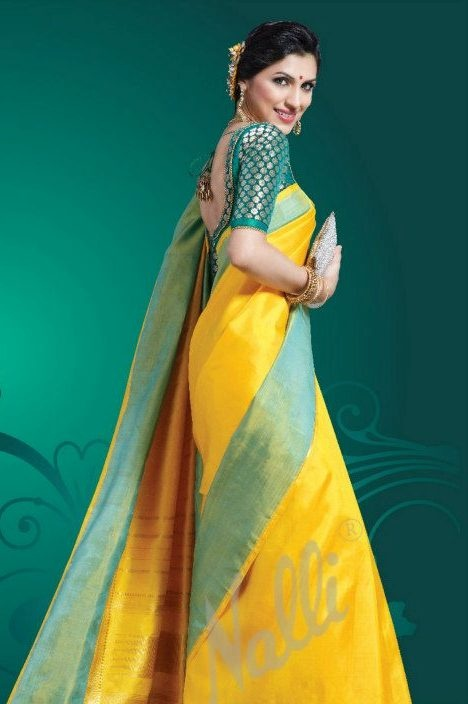 Plain yellow and green lets the beauty of the silk cloth shine through. A long sleeved blouse and a silver clutch complete this look of understated elegance. ---  #indian #wedding