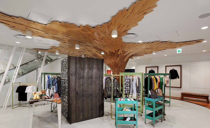 Coudamy Design's 'Bear Cave' ceiling looms over the menswear section, featuring collections by Raf Simons, Damir Doma and House of Billiam