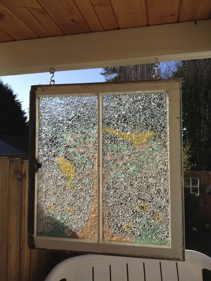Add new life to an old window with craft glass, broken windshield safety glass, E6000 glue topped with a resin pour.