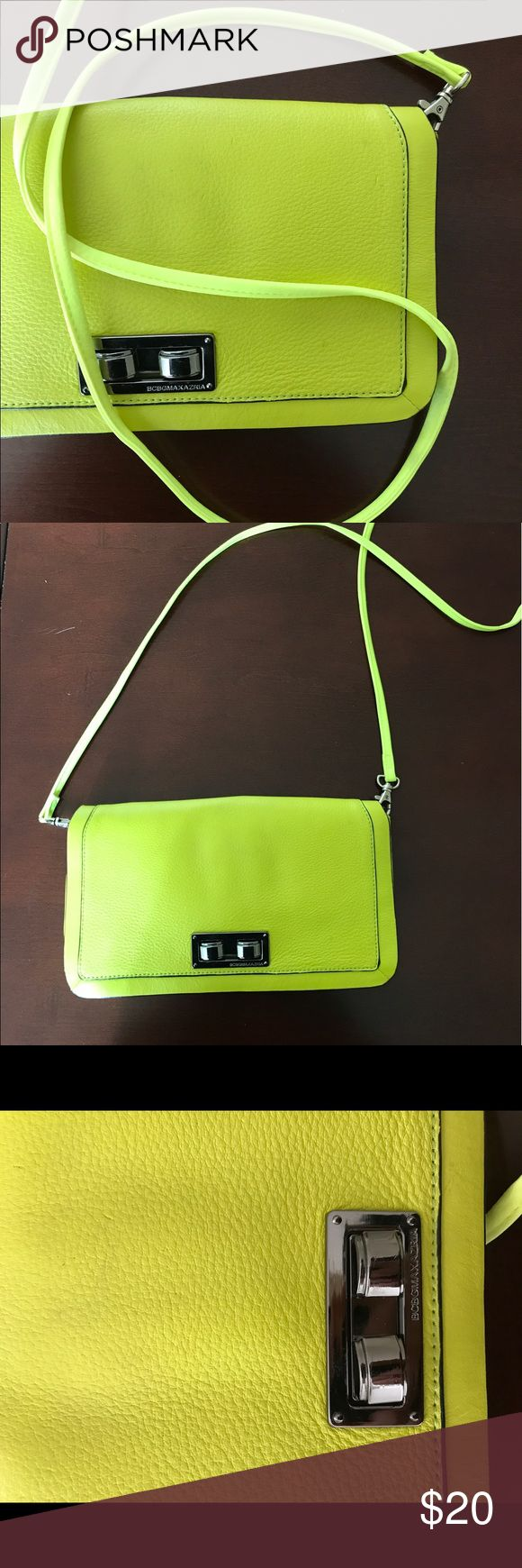 BCBG neon clutch Neon clutch with 2 compartments and 1 zipper pocket. The strap is a slightly different color (brighter). There are a couple scratches on it. BCBG Bags Clutches & Wristlets