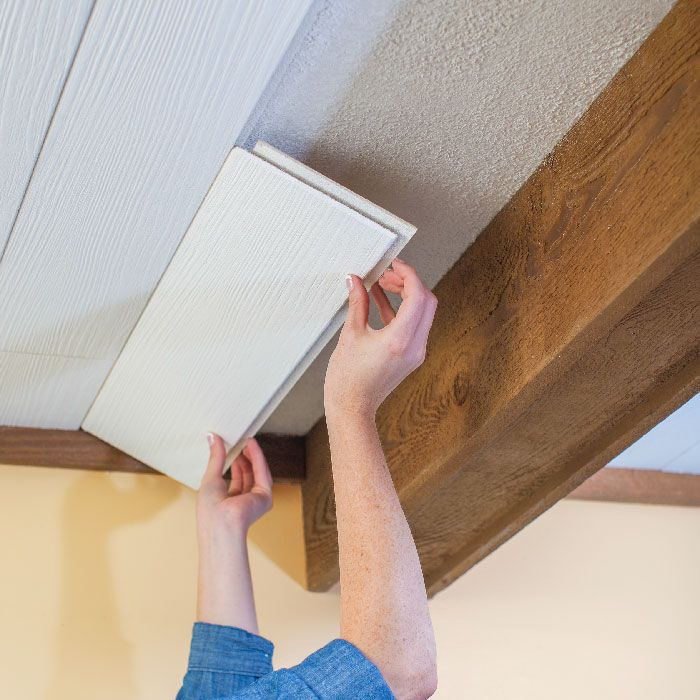 Lowes Creative Ideas tutorial on using planks + a track to cover a popcorn ceiling. Nice alternative to the possible asbestos removal!