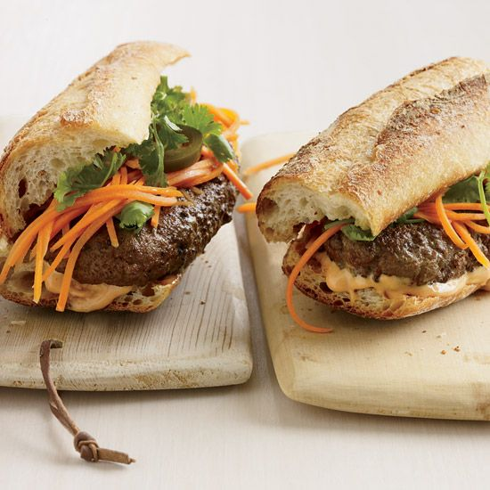 Vietnamese-Style Banh Mi Burgers | Is this an American take on a Vietnamese classic or a Vietnamese take on an American classic? Either way, these spicy burgers topped with Tabasco-spiked mayonnaise, slivers of crunchy pickled carrots and sprigs of cilantro are wonderful.