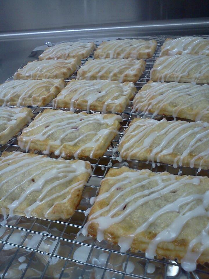 Raspberry Pocket tarts all dressed up in lemon icing